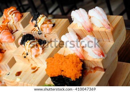 sushi served on wooden board