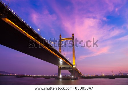 Suspension bridge at sunset, Fujian,China - stock photo