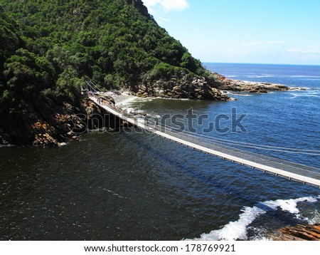 suspension bridge over storm river, tsitsikamma national park, south africa - stock photo