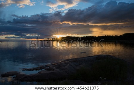 Swedish east coast in sunset - stock photo