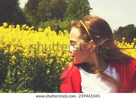 Sweet little girl outdoors. Toned - stock photo