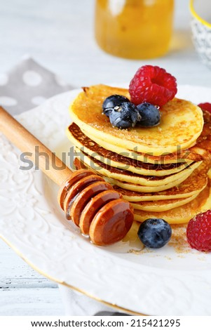 sweet pancakes on a plate, side view - stock photo