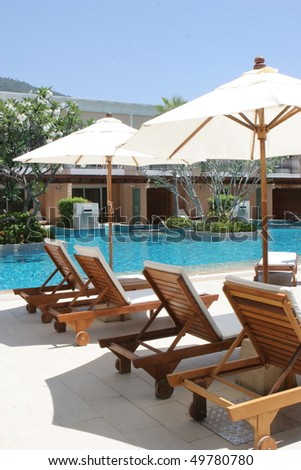 Swimming pool at a luxurious resort in Thailand - travel and tourism. - stock photo