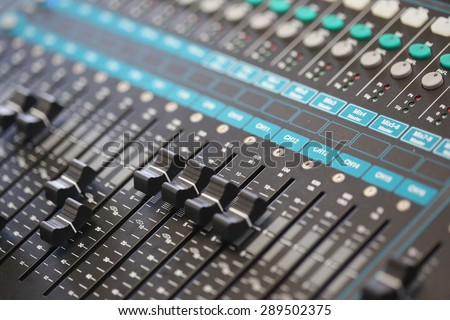 switch, sound controller, mixer board, Buttons and tabs in various parts of the audio controller mixer ,music,mixer in studio,audio sound mixer with buttons and sliders
