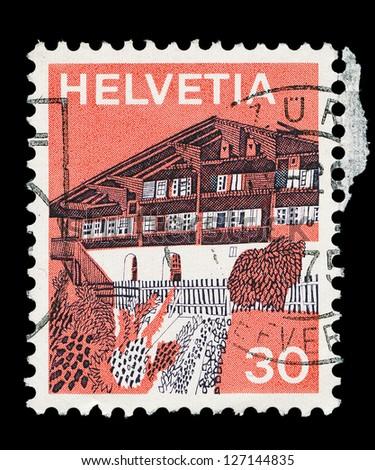 SWITZERLAND - CIRCA 1973: a stamp printed in the Switzerland shows Village in Simme Valley, Switzerland, circa 1973 - stock photo