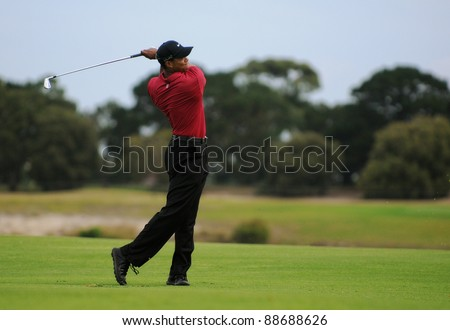 SYDNEY - NOV 13: American golfer Tiger Woods plays a iron from the 17th fairway in his fourth round at the Emirates Australian Open at The Lakes golf course. Sydney - November 13, 2011 - stock photo