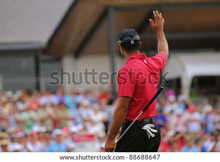 SYDNEY - NOV 13:  American golfer Tiger Woods waves goodbye to the crowd at the Emirates Australian Open at The Lakes golf course. Sydney - November 13, 2011 - stock photo