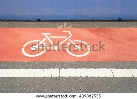 Symbol for bicycle path on the road.