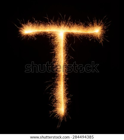 """T"" letter drawn with bengali sparkles isolated on black background"