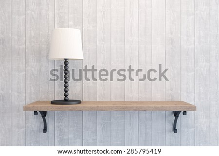 table lamp on the empty shelf - stock photo
