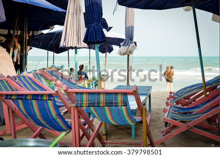 Tables and chairs on the beach