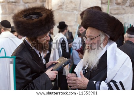 Talk Jews at the Western Wall in the Sukkot holiday. - stock photo