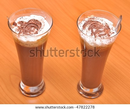 tall cup of fresh coffee latte with whipped cream - stock photo