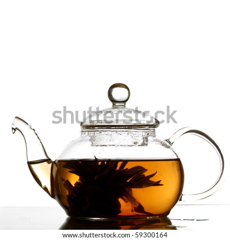 tea in glass pot isolated - stock photo