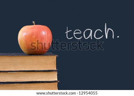 """teach"" written on blackboard with apple and books - stock photo"