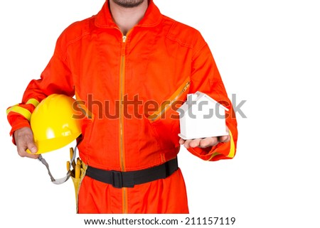 technician in uniform holding hard hat  and presenting a small model of a house on a white background isolated on white background