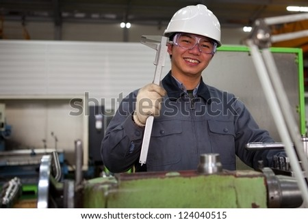 technician working in factory looking at camera