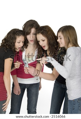 4 teen girls with cell phone - stock photo
