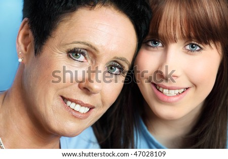 Teenage daughter and  mature mother portrait, close up
