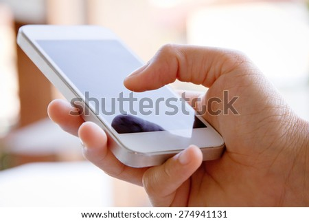 Teenage girl text messaging on her phone  - stock photo