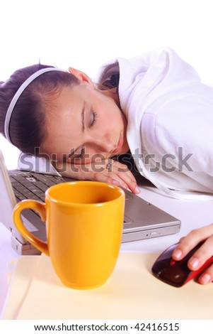 Teenager Drinking Coffee While Working on the Computer Fell Asleep - stock photo
