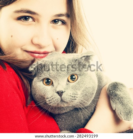 Teenager girl with Scottish Fold gray cat, instagram style - stock photo