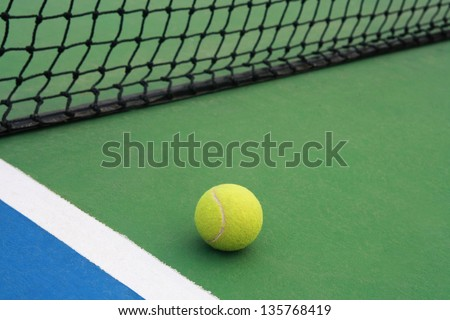 ,tennis ball on green blue court and net in sport competition background, sport club