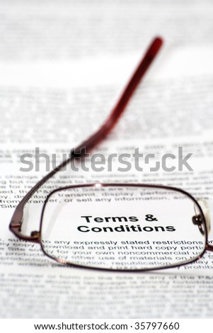 """Terms and condition"" words focused thought glasses - stock photo"