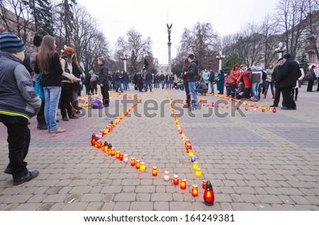 TERNOPOL, UKRAINE-NOV. 23: Ukrainian action memory ''Memory of the victims of famine'' 80 anniversary (Golodomor) inTernopol, Ukraine on November 23, 2013. - stock photo