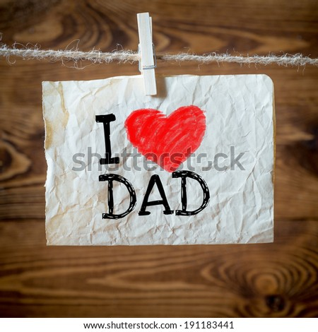 Text I love dad on the old paper and clothes peg wood background - stock photo