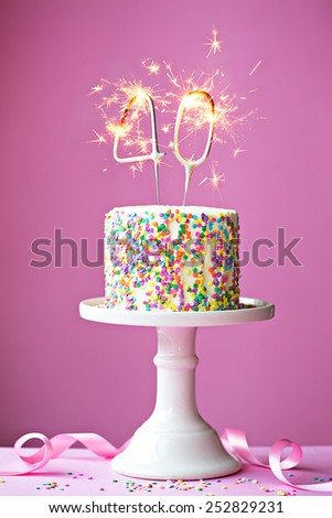 40th birthday cake with sparklers - stock photo