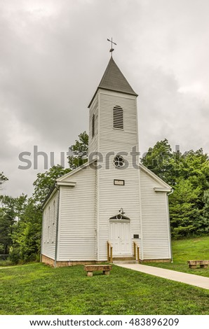 19th century church built in 1880 has a steeple and a weather vane