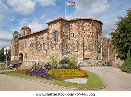 11th century Norman castle in Colchester in springtime and UK flag. - stock photo