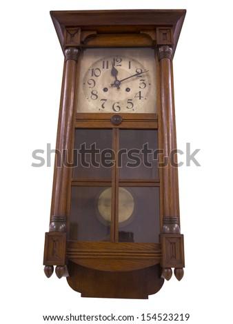19th Century old pendulum wooden clock isolated on the white  - stock photo