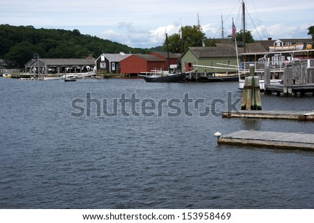 19th century sailing ships and riverside wharfs  along the Thames river, of Old Mystic Seaport, Connecticut  - stock photo