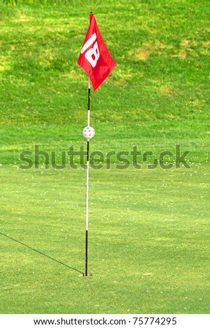 18th flag on the golf course - stock photo