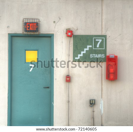 7th floor exit with fire alarm - stock photo