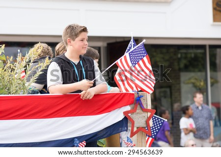 4 Th July 2015, Barnstable county, Massachusetts, USA  Boy holding an American flag