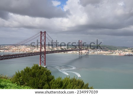 25th of April Bridge, Lisbon, Portugal. This bridge connects the two banks of the Tagus River between Lisbon and Almada. - stock photo