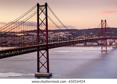 25th of April Suspension Bridge in Lisbon, Portugal - stock photo