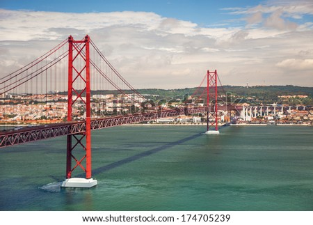 25th of April Suspension Bridge over the Tagus river in Lisbon, Portugal, Eutope  - stock photo