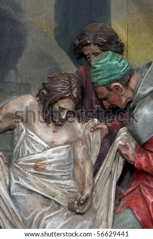 14th Stations of the Cross, Jesus is laid in the tomb and covered in incense - stock photo