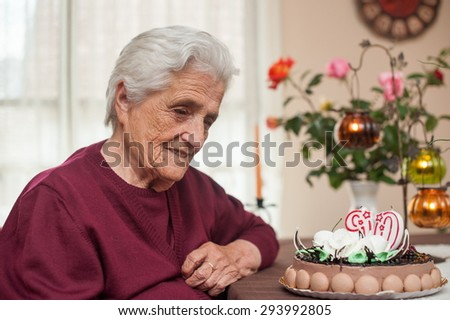 90th years old candles and cake in birthday party - stock photo