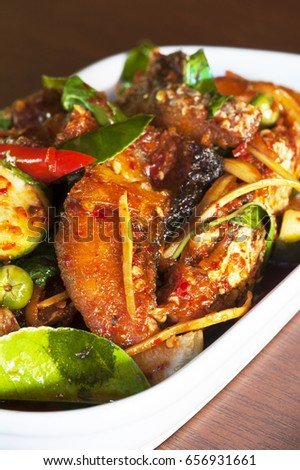thai cuisine - fish with chilli paste - fish hot and spicy mixed eggplant
