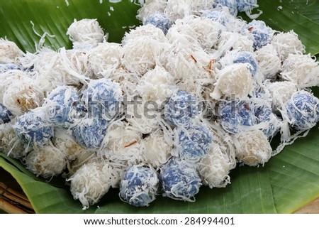 Thai dessert with coconut slide on banana leave - stock photo