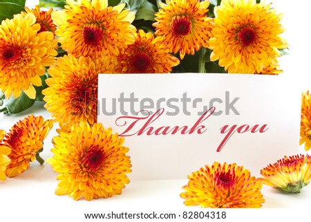 """thank you"" on a background of orange chrysanthemums - stock photo"