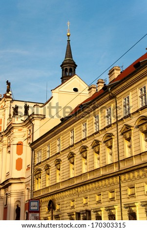 The ancient building in Prague against the blue sky, the Czech Republic   - stock photo
