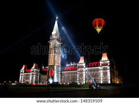 The beautiful light show projected on the parliament building  - stock photo