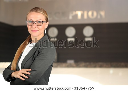 The Beautiful smiling business woman  portrait. Smiling female receptionist - stock photo