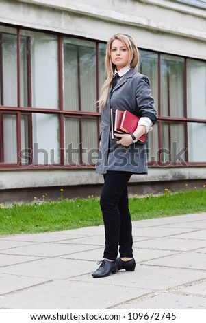 The blond girl with books - stock photo